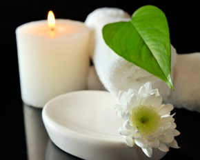Candle, towel, flower, leaf and bowl